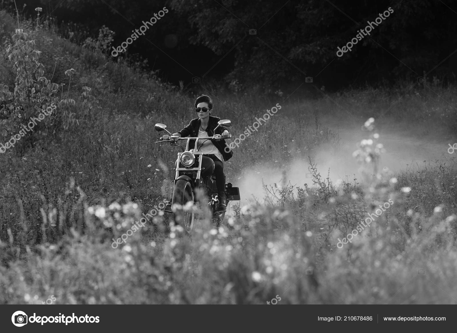 Attractive stylish dangerous girl riding motorcycle deserted nature black white stock photo
