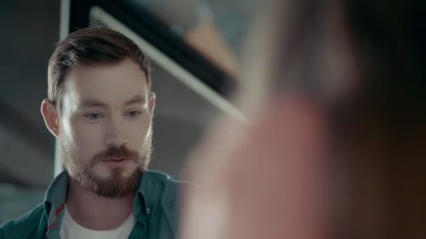 European Young Man With Beard Emotionally Expresses Opinion At Team Meeting To Female Team Leader