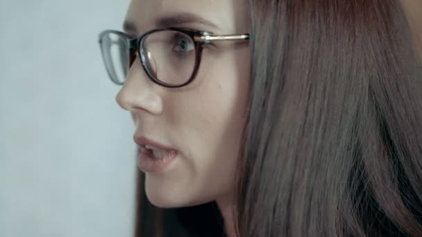 Face Of Young European Female Team Leader In Glasses Expresses Dissatisfaction At Team Meeting