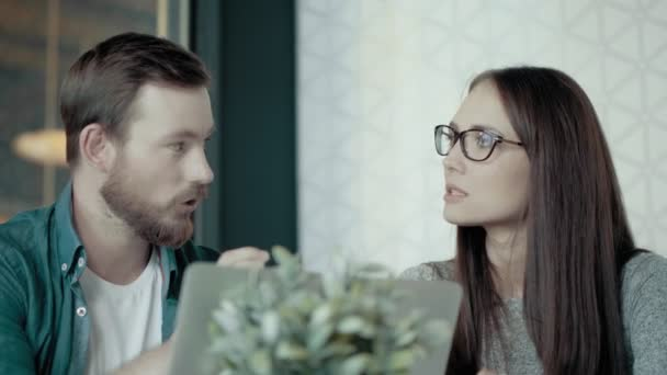 Casual Female Team Leader And European Man Discussing New Start Up Project In Modern Office
