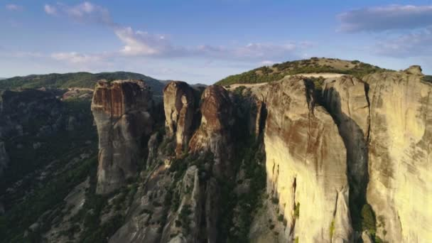 Rollback or pullback aerial shot of amazing natural mountain complex formation Meteora in Greece