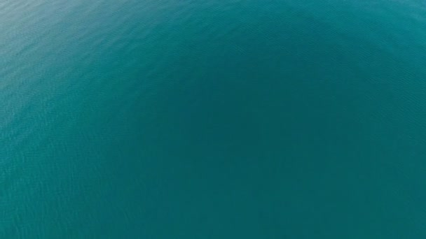 Top view calm turquoise sea surface amazing ocean water with small waves and ripples texture