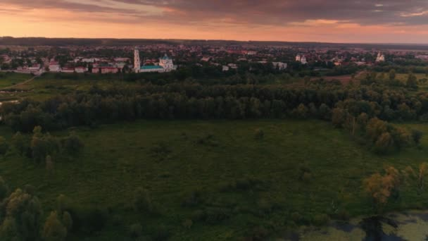 Beautiful landscape typical suburb surrounded by dense green forest at sunset aerial shot