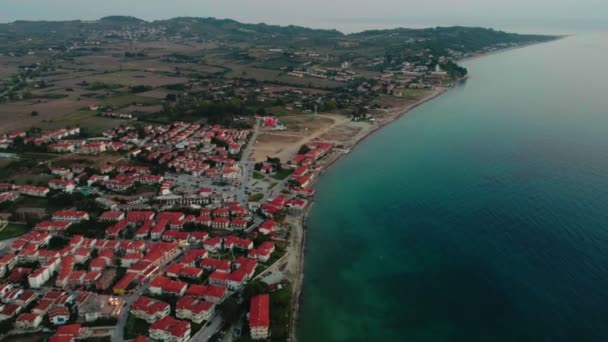 Aerial shot amazing coastline with beautiful small European city and wonderful blue sea