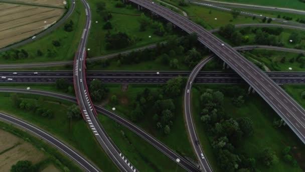 Reverse aerial shot road junction modern asphalt marking highway having few roadway