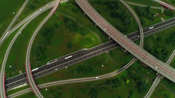 View from above circle ring multilevel road junction with busy traffic moving car aerial shot