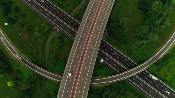 Top view smooth covering of marking asphalt winding road with busy transport traffic aerial shot