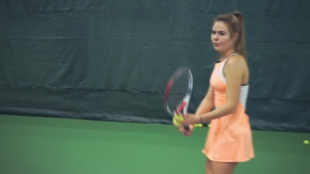 Girl tennis player triumphs that scored