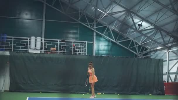 Professional tennis player trains. Practicing a blow