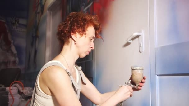 woman tries to draw and checks paint balance in airbrush