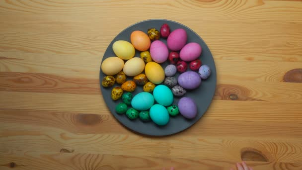 Children hand take colored Easter eggs