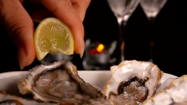 Lemon juice dripping on fresh oysters