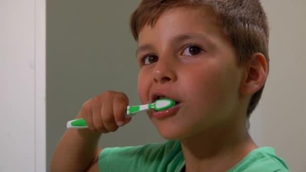 Boy cleans his teeth