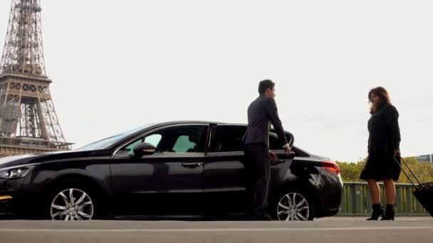 Personal driver is opening car door for women