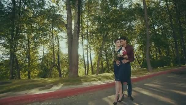 Sensitive outdoor portrait of beautiful couple softly touching in park