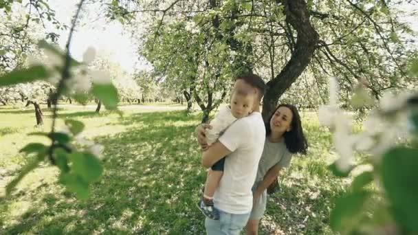 Happy family concept. Family have fun outdoors. Smiling parents with little son
