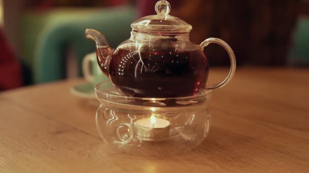 Tea time. Teapot with tea at table