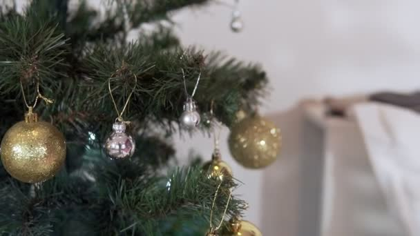 Christmas tree decorated with sparkly christmas tree toys and shining lights. New Year mood. Merry Christmas