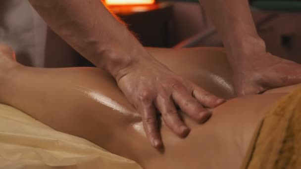 Close-up of Therapist applying pressure on female leg. Relaxing body procedure.