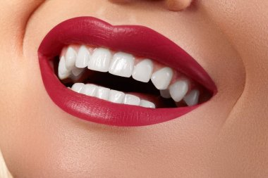 Macro Happy Female Smile with Healthy White Teeth. Bright Red Lips Make-up. Stomatology and Beauty Treatment, Whitening. Clean Skin