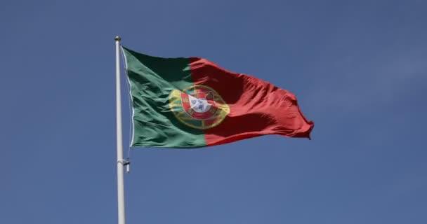 Flag of Portugal waving against blue sky