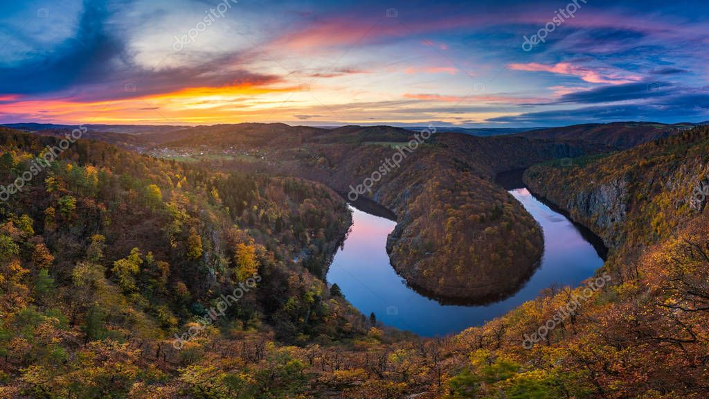 Panoramic view of river canyon with dark water and autumn colorful forest. Horseshoe bend, Vltava river, Czech republic. Beautiful landscape with river. Maj lookout.