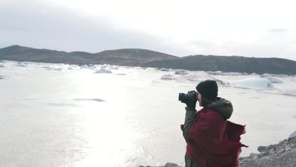 Girl takes a photo of frozen lake