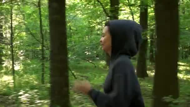 girls jogging in the forest close-up