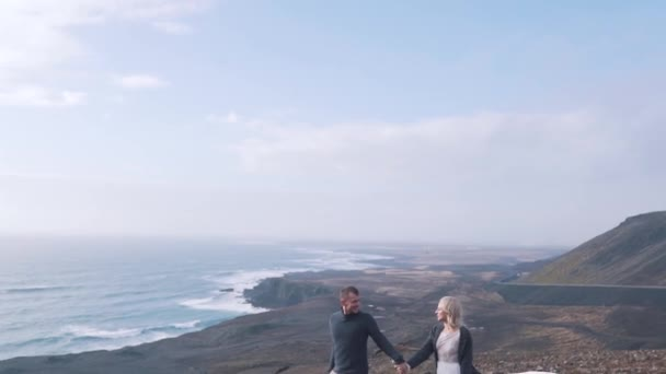 young couple on the coast of Iceland
