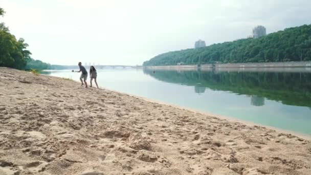 couple having fun by the river in Kiev