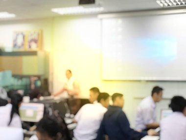 Education concept, Abstract blurred background image of students and business people  studying and discuss in large hall profession seminar with screen and projector for showing information.