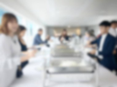 Abstract blur image of Lunch break education people and student in line wait for food meals from table on catering and buffet party on business seminar conference. vintage tone color.