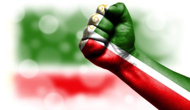 Flag of Chechen Republic painted on fist