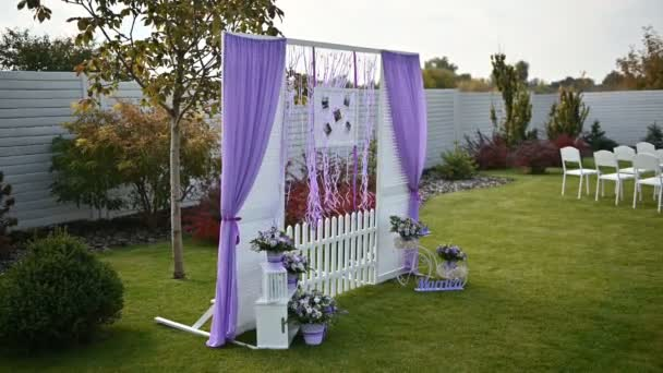 Wedding ceremony decoration on wind. Wind blows colorful ribbons in spring sunlight