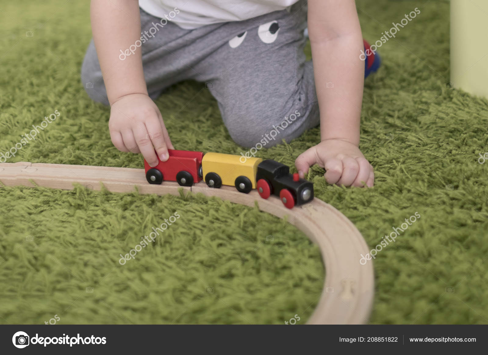 Small toddler in a colorful children room in a nursery or