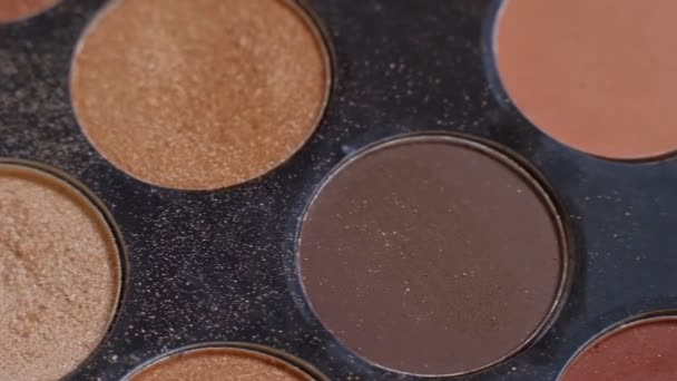 Palette of cosmetic eye shadow for make-up. Fashion and beauty background. Close up view. macro shooting. macro shooting