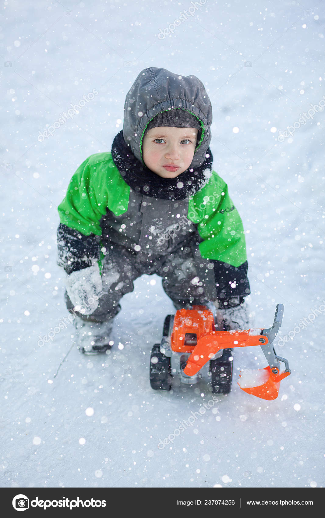 009165372 Portrait Cute Little Toddler Sitting Snow Playing His Yellow Tractor ...