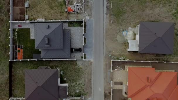 aerial view of houses on housing estates, some with building on roof panels
