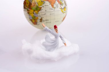 Sufi dervi on white cloud near globe