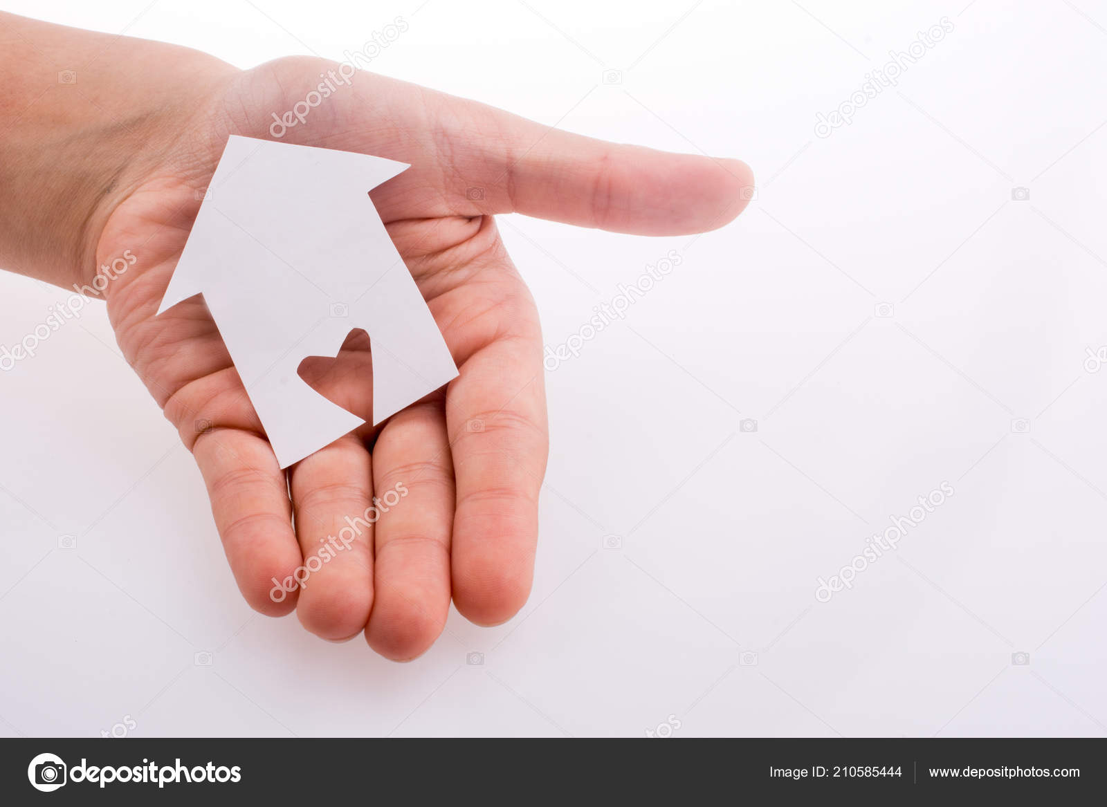 Stupendous Hand Holding Paper House Heart Carved White Background Home Remodeling Inspirations Genioncuboardxyz