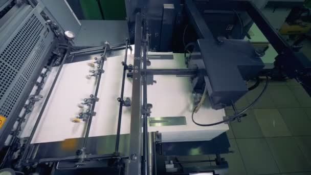 Paper production machine. Processing of secondary resources. Special equipment works at a print office.