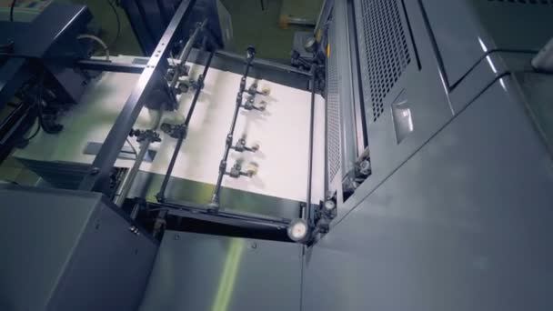 Paper recycling. Factory machine works automatically, top view.