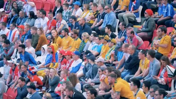 Kazan, RUSSIA - JUN 16, 2018: Football fans sit on a grandstand. FIFA footbal world championship 2018.