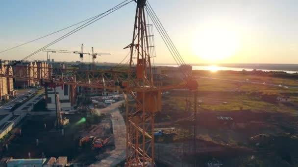 Building equipment on a construction site. Construction Site At Sunset timelapse silhouette