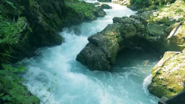 Wild water flow is running along the canyon stones