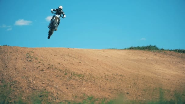 Slow motion jumping trick of an FMX racer