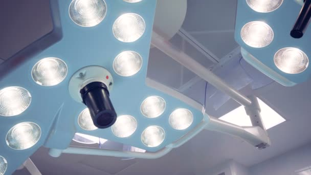 Two functioning surgical lamps of irregular shape
