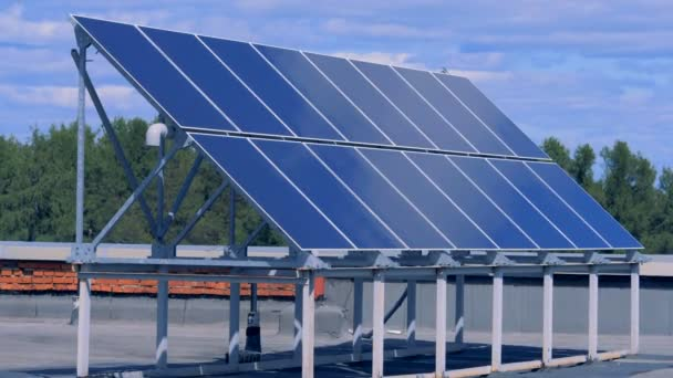 Solar panel installation located on a roof of a building
