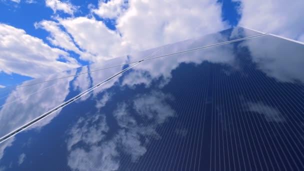 Flat glasslike surface of a solar platform is reflecting blue sky