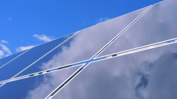Reflection of the cloudy blue sky on a smooth surface of a solar module